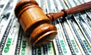 court gavel and settlement money