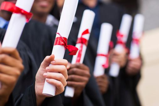 graduates with diplomas